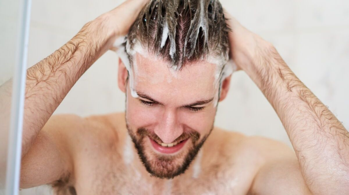 bearded man washing facial hair