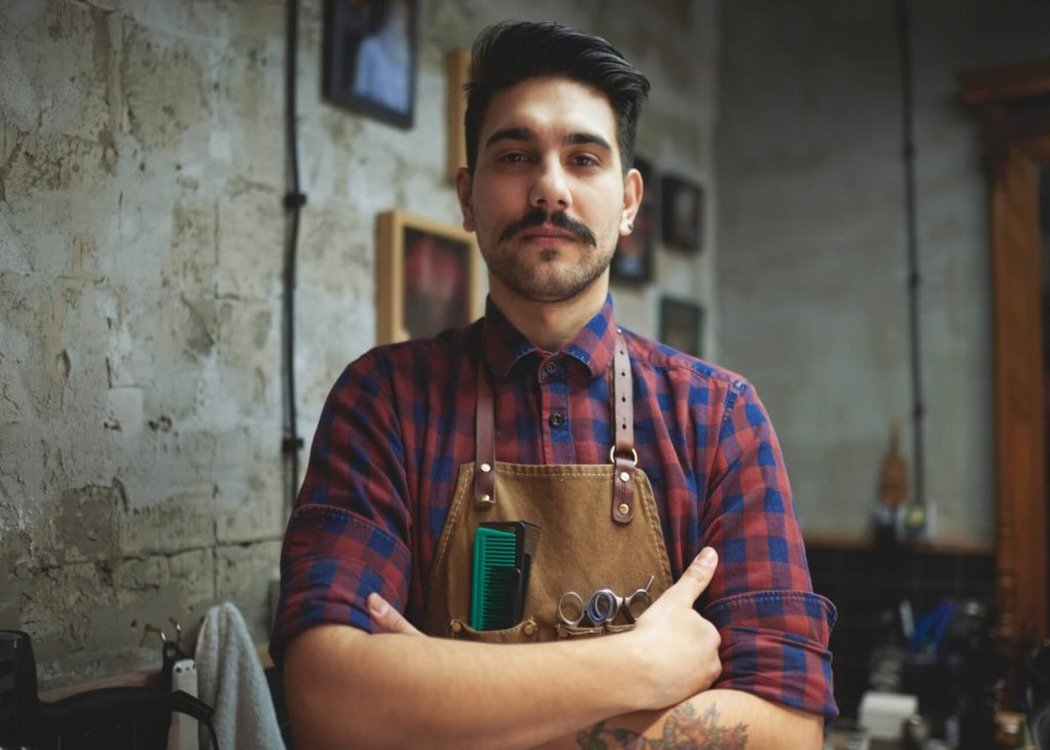 man with a chevron moustache