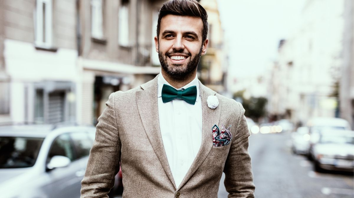 man dressed in formal layers