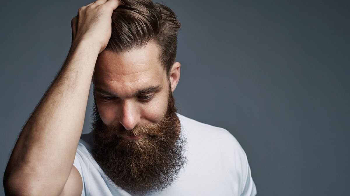 Hide a receding hairline and showcase your personality with a faux hawk-style haircut.