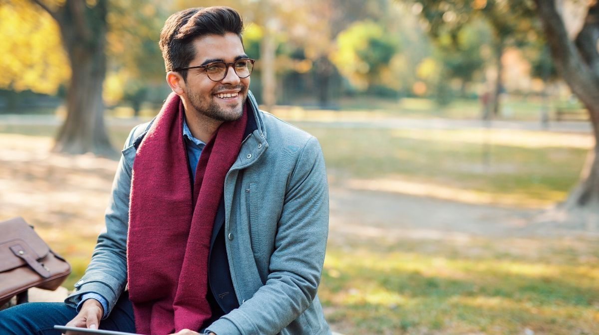 man outdoors in winter soaking up vitamin D to boost his mood