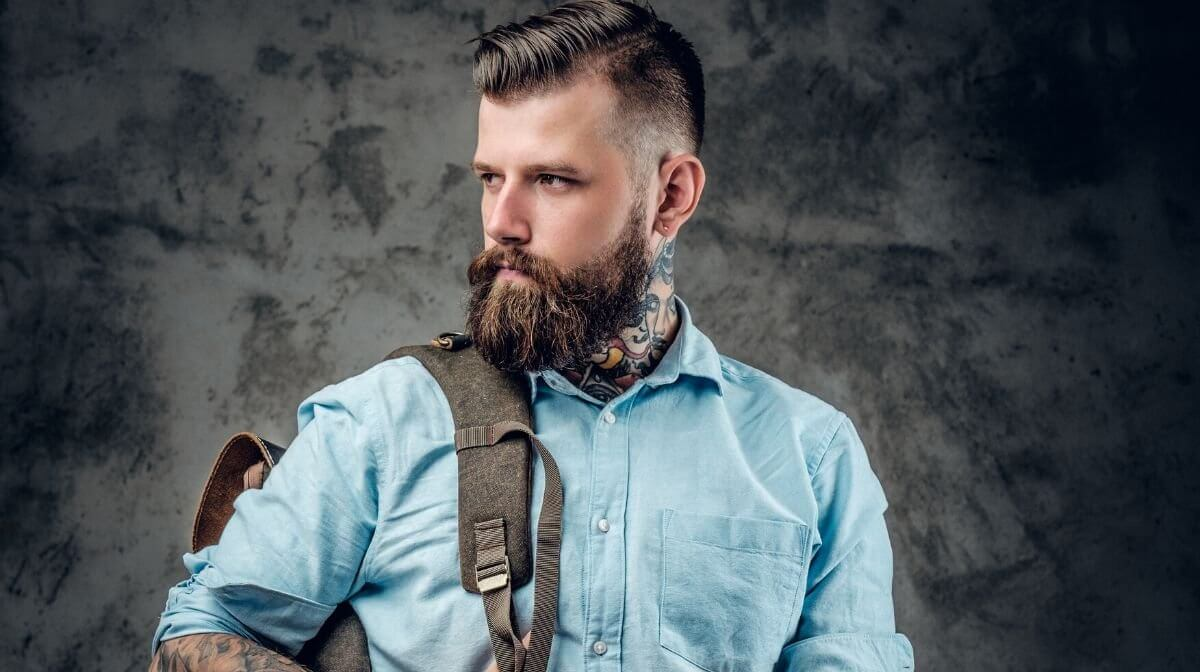 smart-looking, bearded man with tattoos
