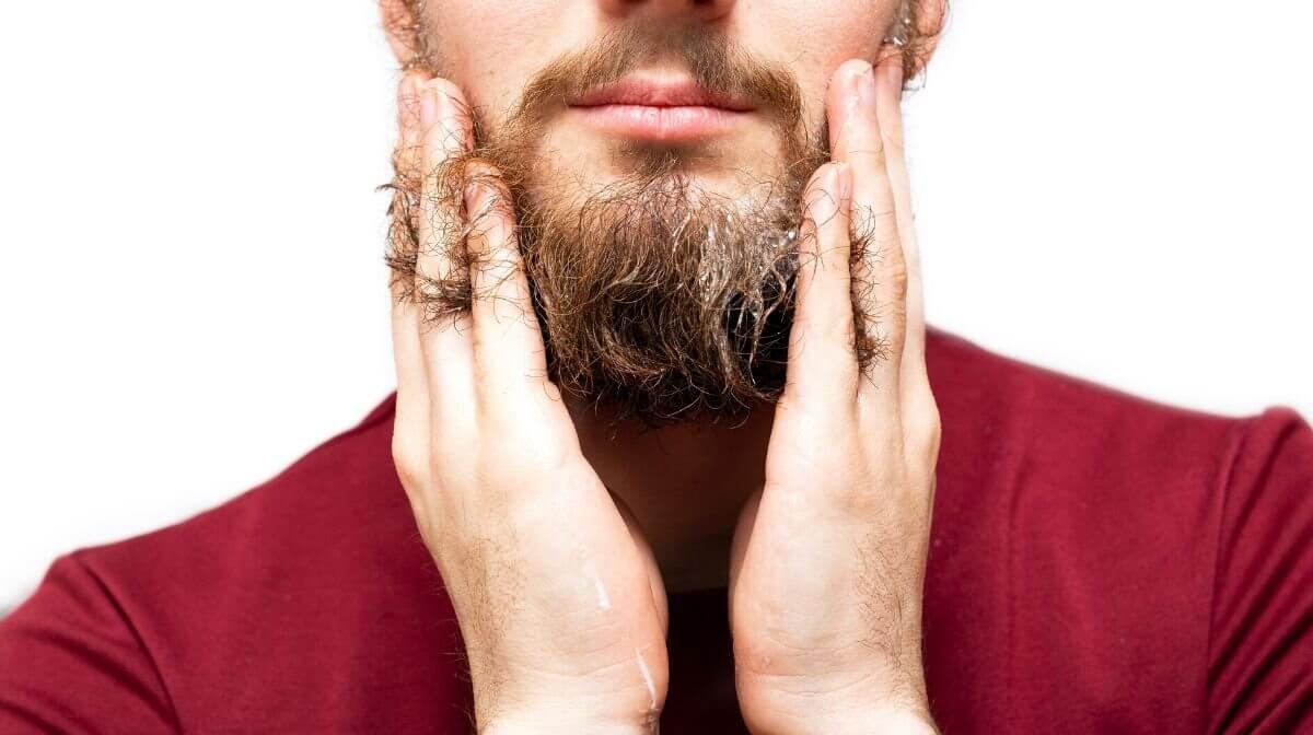 man washing beard