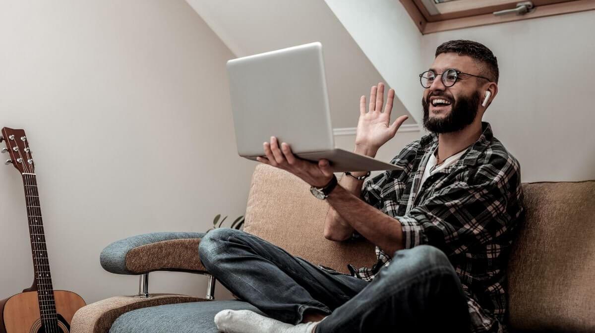 man speaking to loved ones via video call