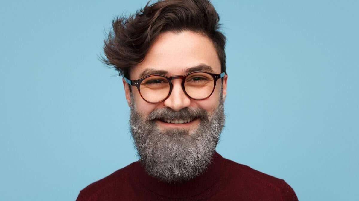 man with dyed hair a grey beard