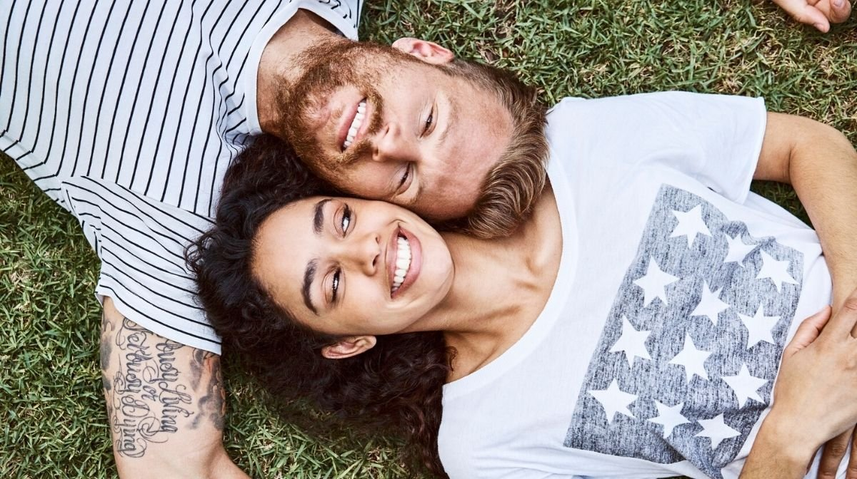 close-up on man and woman lying on grass