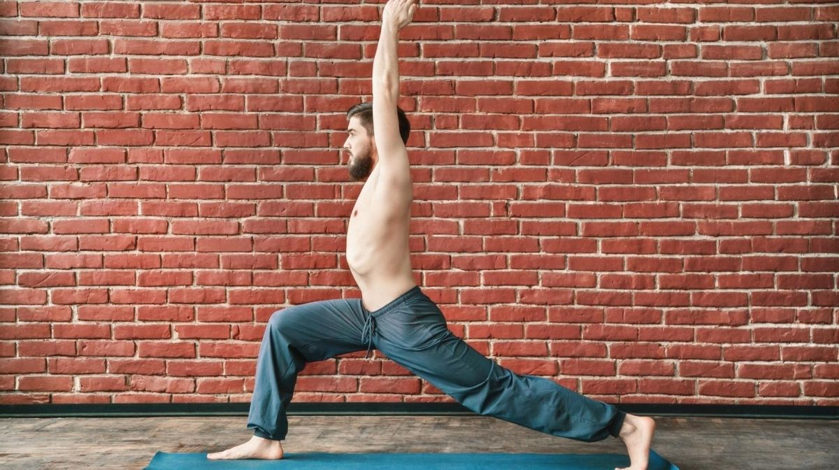 man in the warrior yoga pose