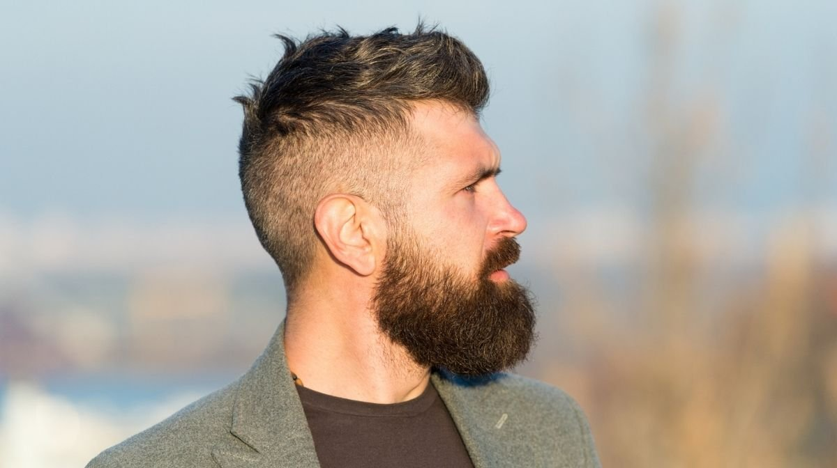 side profile of a man with a well-groomed beard