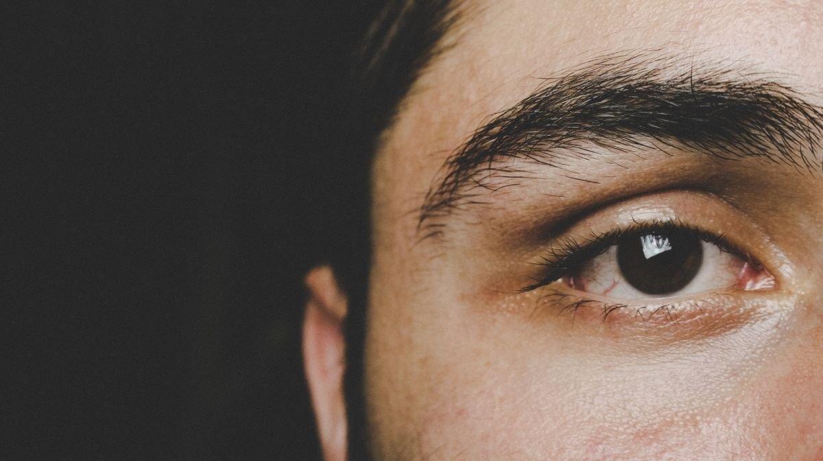 man's groomed eyebrows