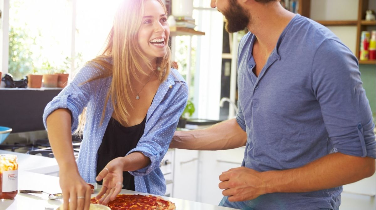 couple making pizza together