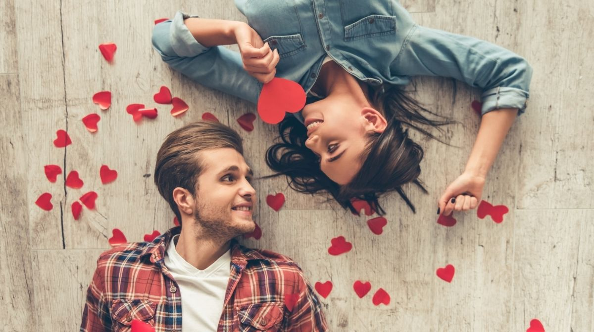 man and woman surrounded by heart confetti