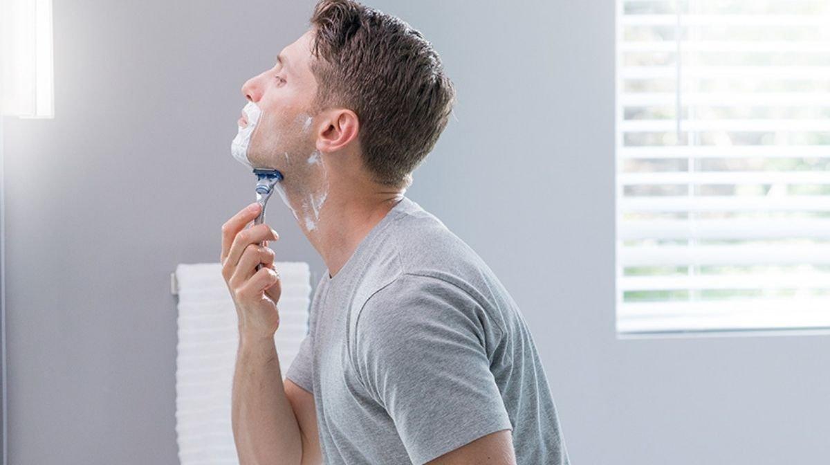 man shaving with a Gillette razor