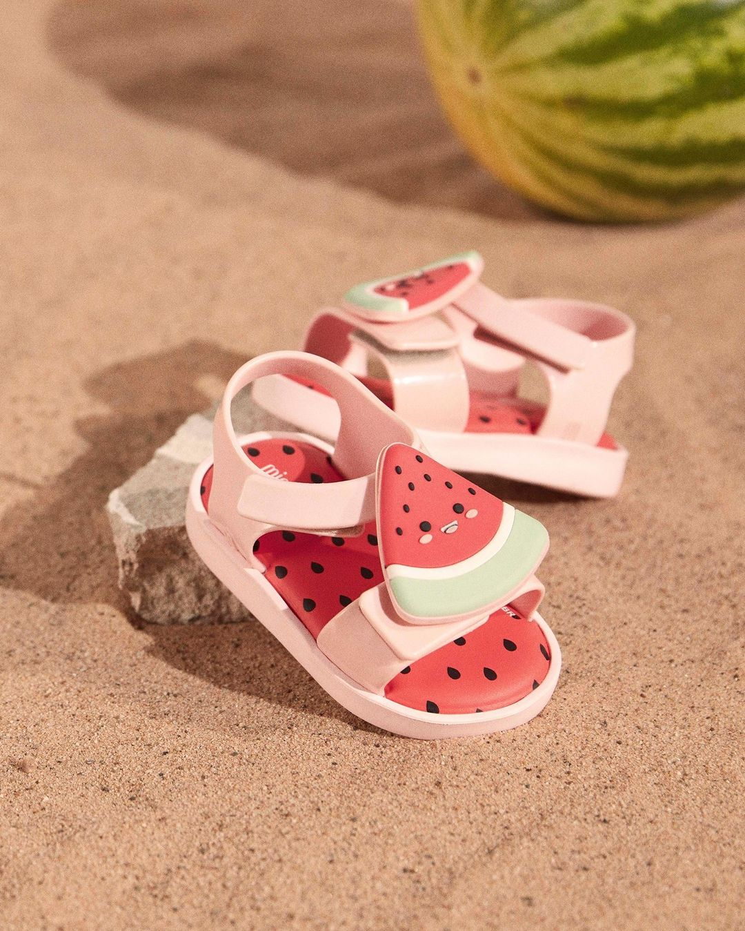 pink water melon sandals on the sand