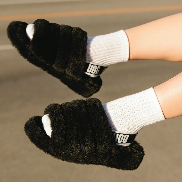 Someone wearing ugg slippers and white socks