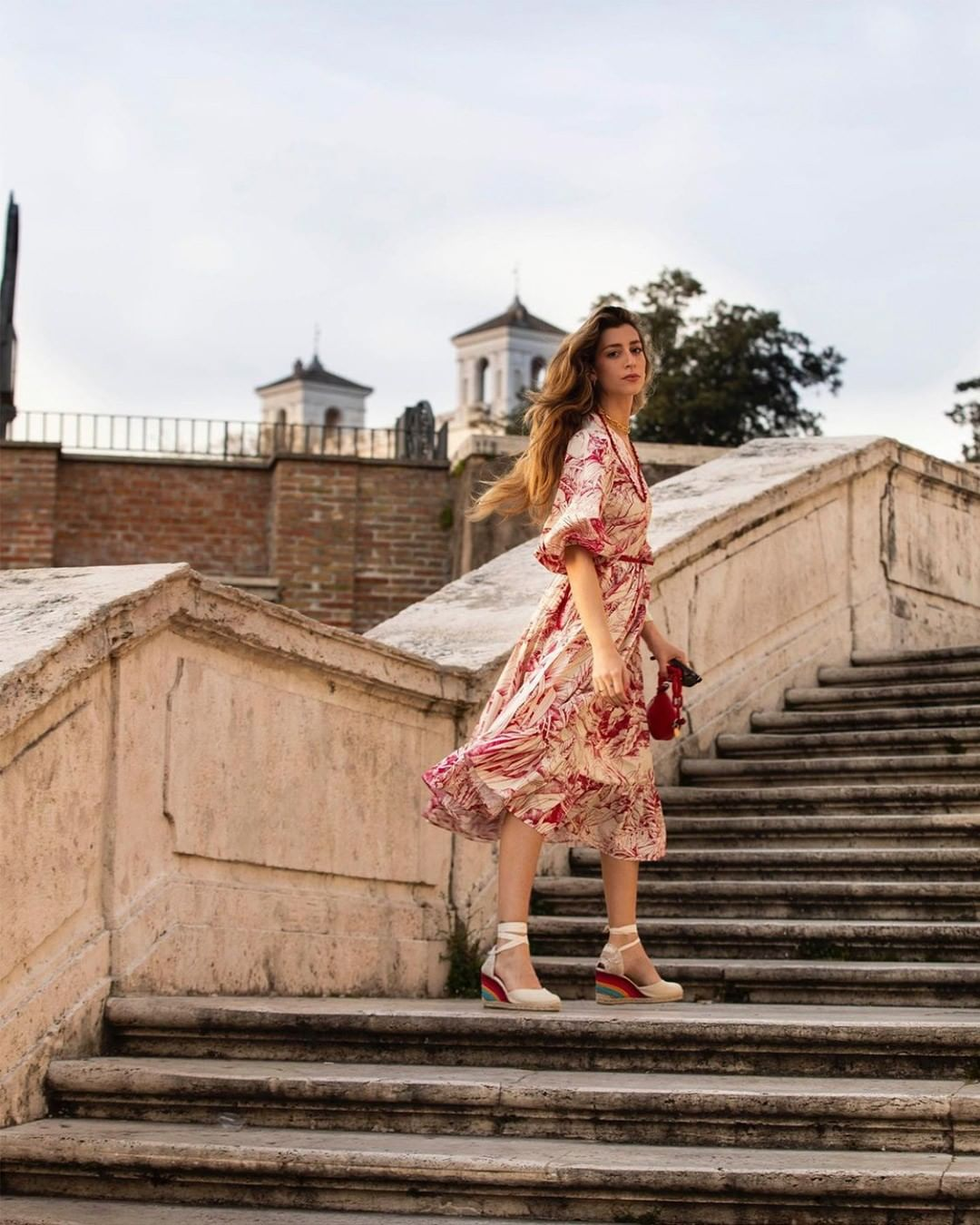 Women stood on some steps with Castañer x PS Paul Smith Espadrilles on