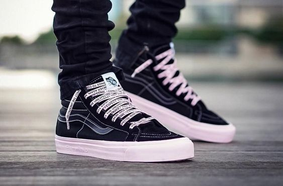 Close up of someone wearing van trainers