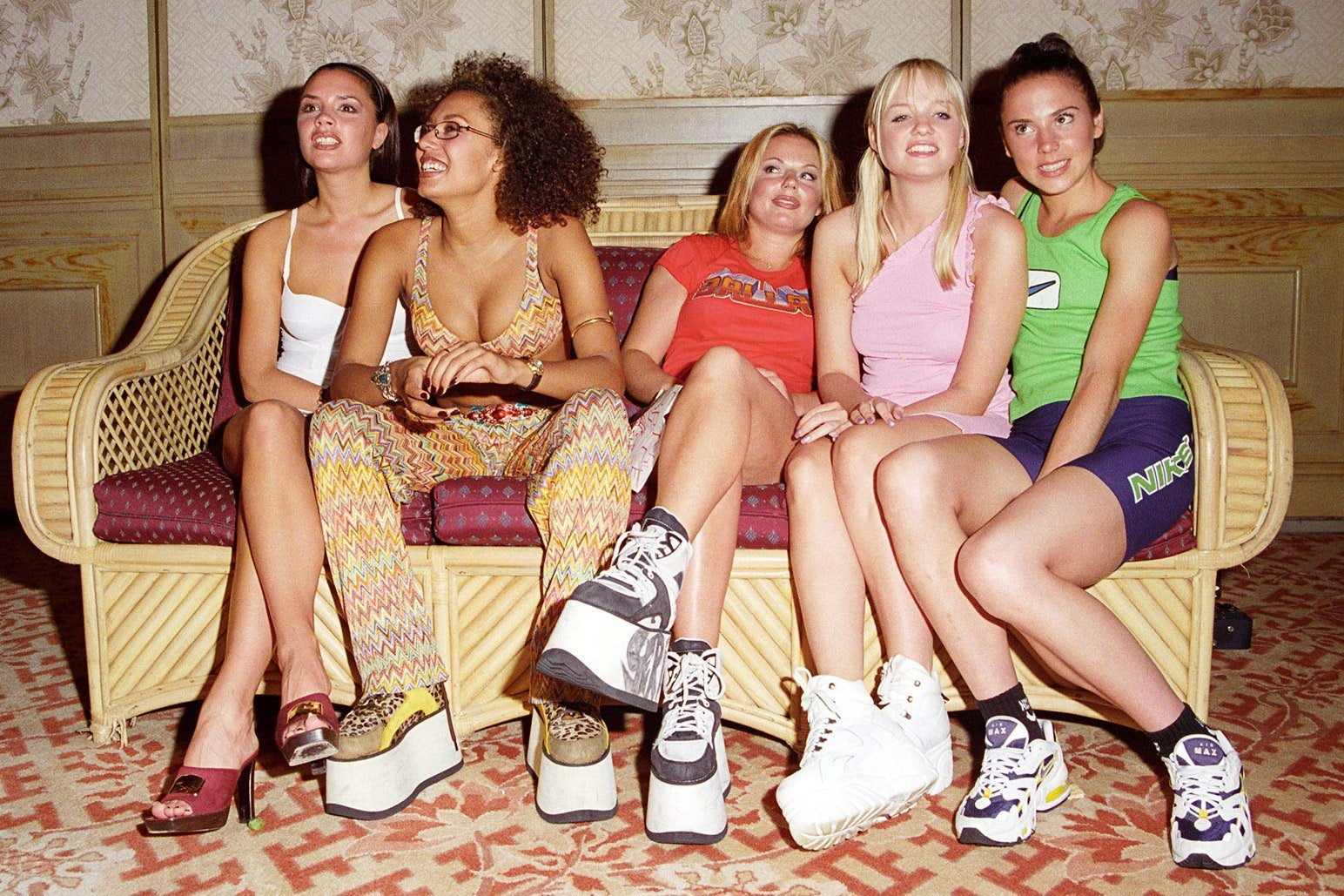 The spice girls sitting on a sofa