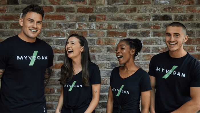 4 people laughing in Myvegan T-shirts