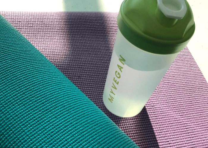 Myvegan shaker on yoga mat