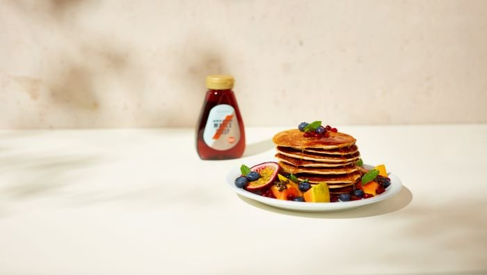 fruit pancakes and maple syrup
