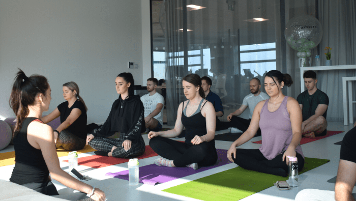 group sitting in yoga position