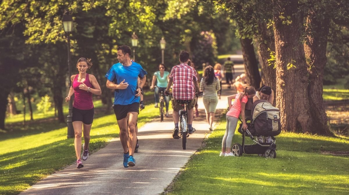people social distancing while exercising outdoors