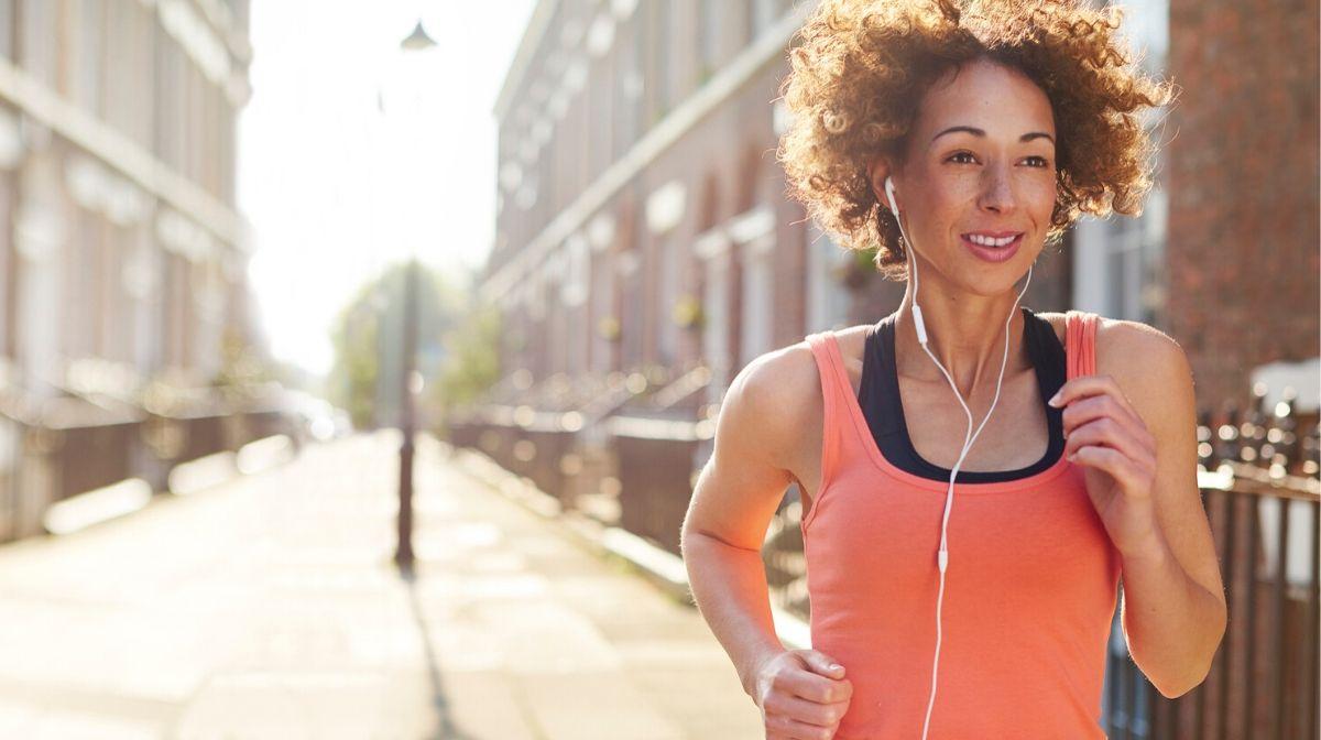 woman running down a quiet street