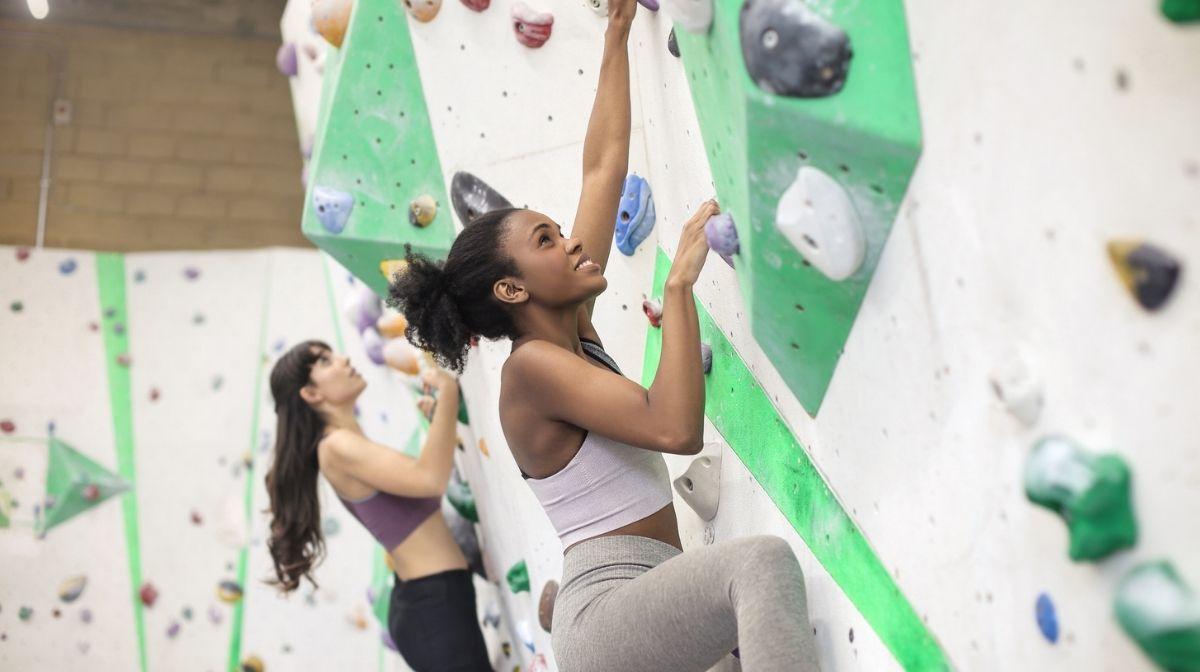 women using climbing wall