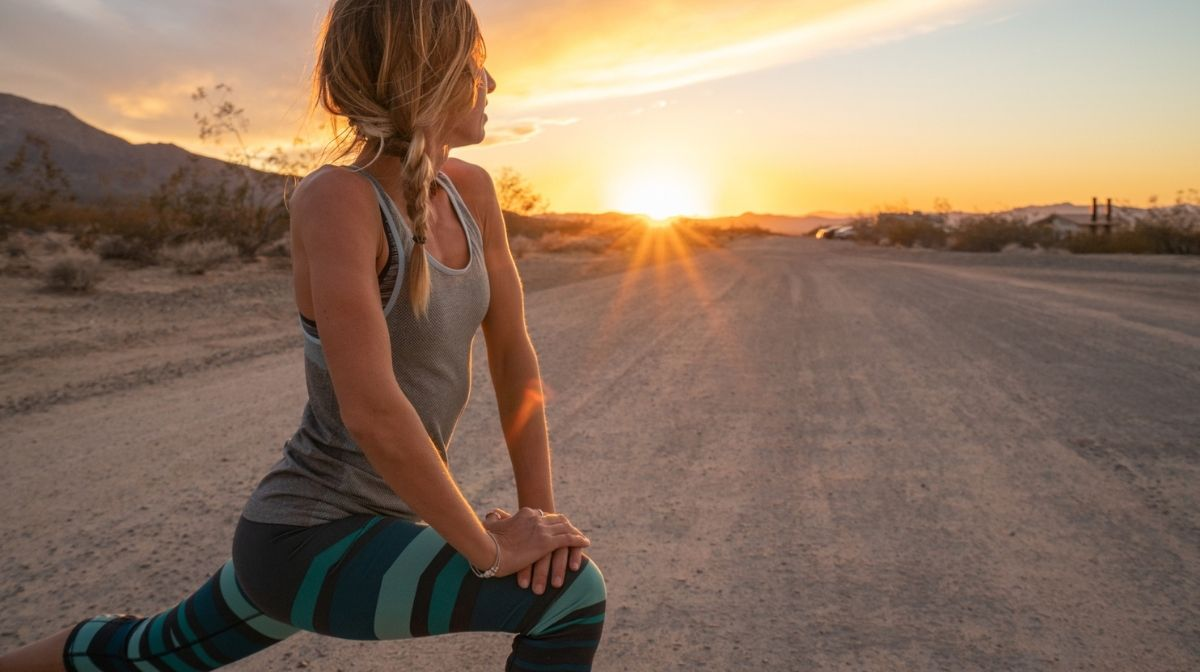 woman stretching before exercise at sunrise