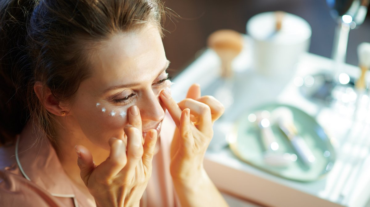 woman learning how to apply eye cream