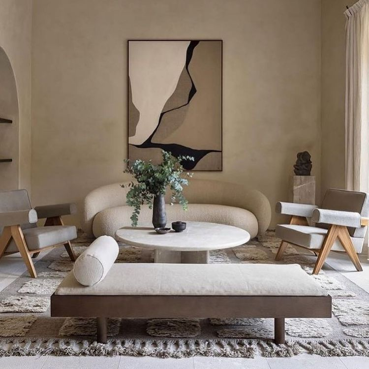 Neutral living room with wall art and a plant