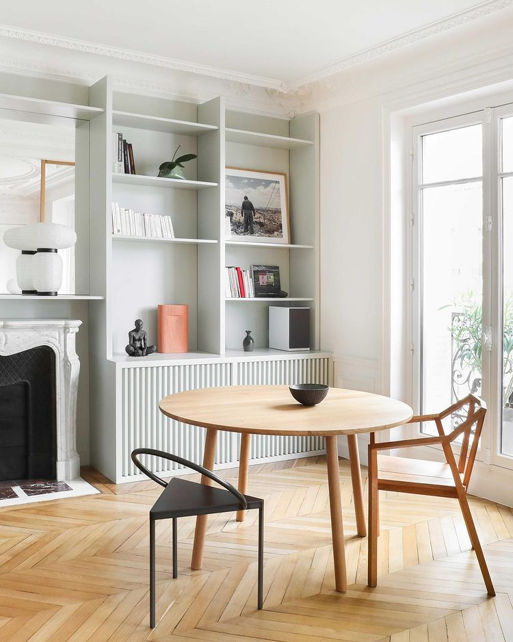 Dining table and chairs with a bookcase