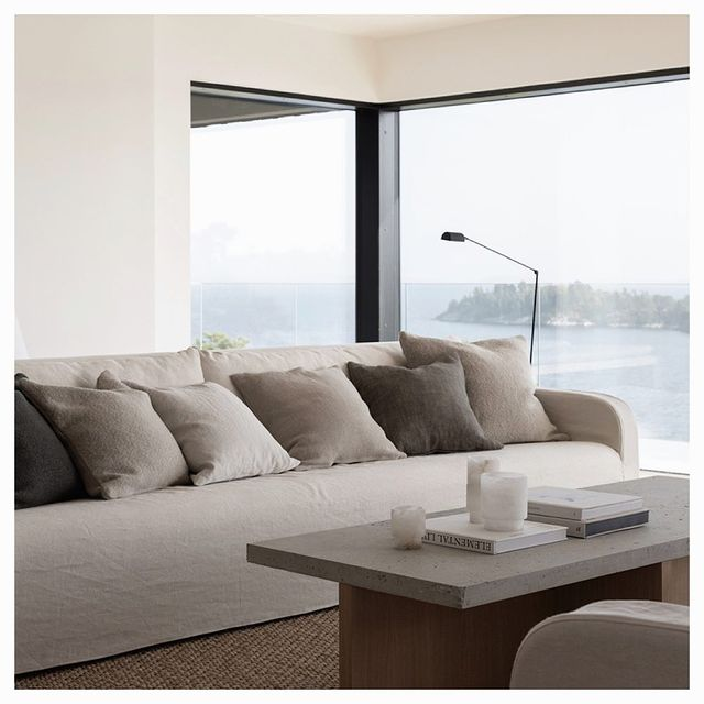 Sofa and coffee table infront of a big window