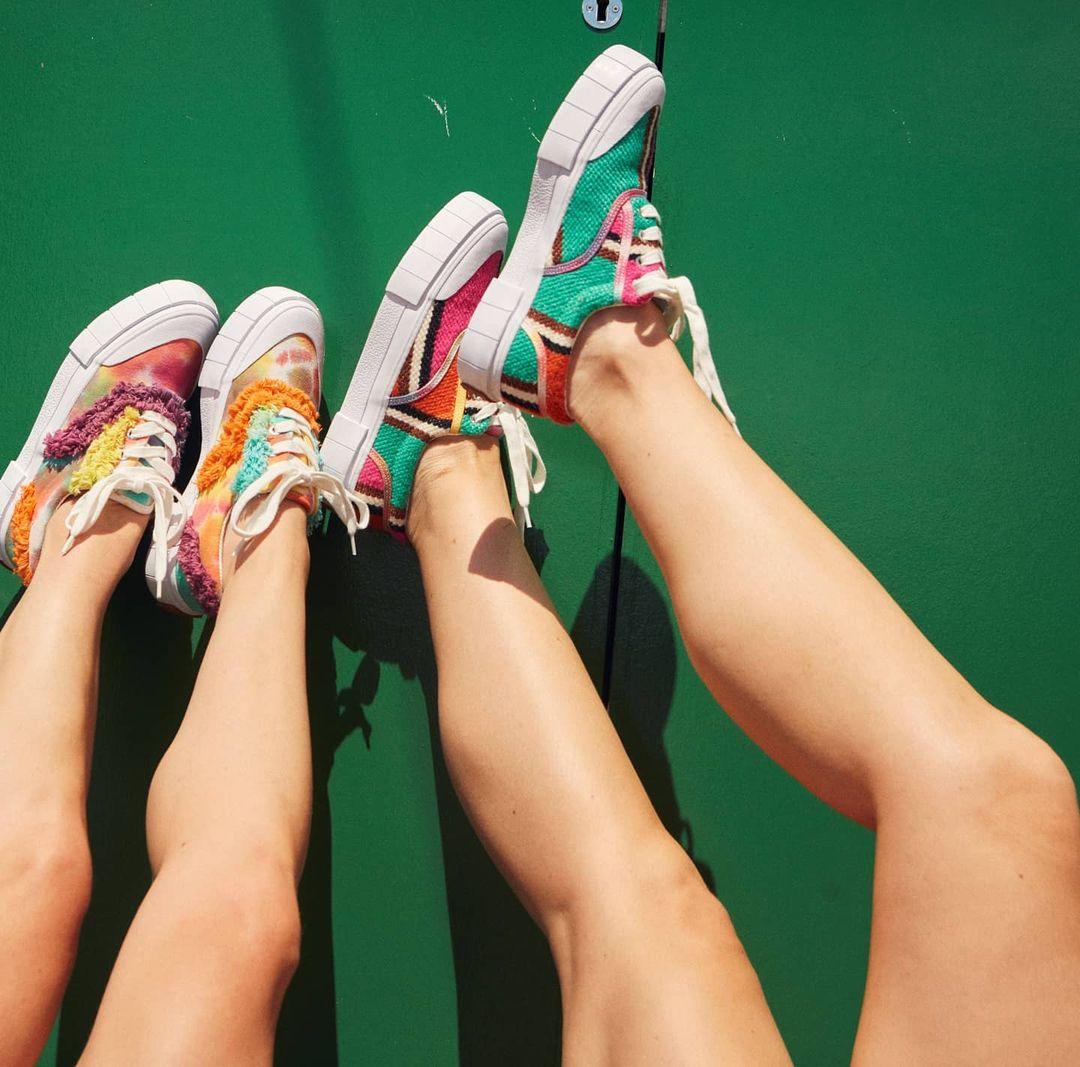 Girls wearing Good News trainers