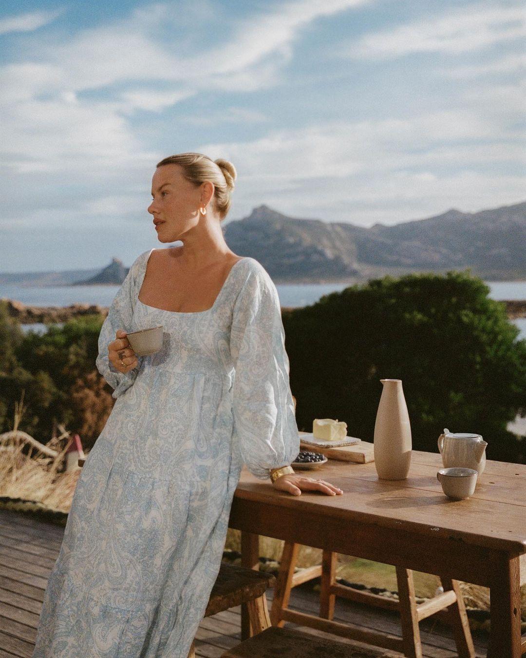 Women wearing a dress on a balcony