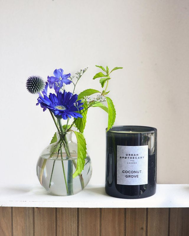 Urban apothecary candle and flowers