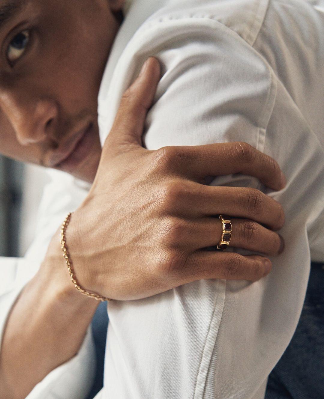 Man wearing Tom Wood Jewellery