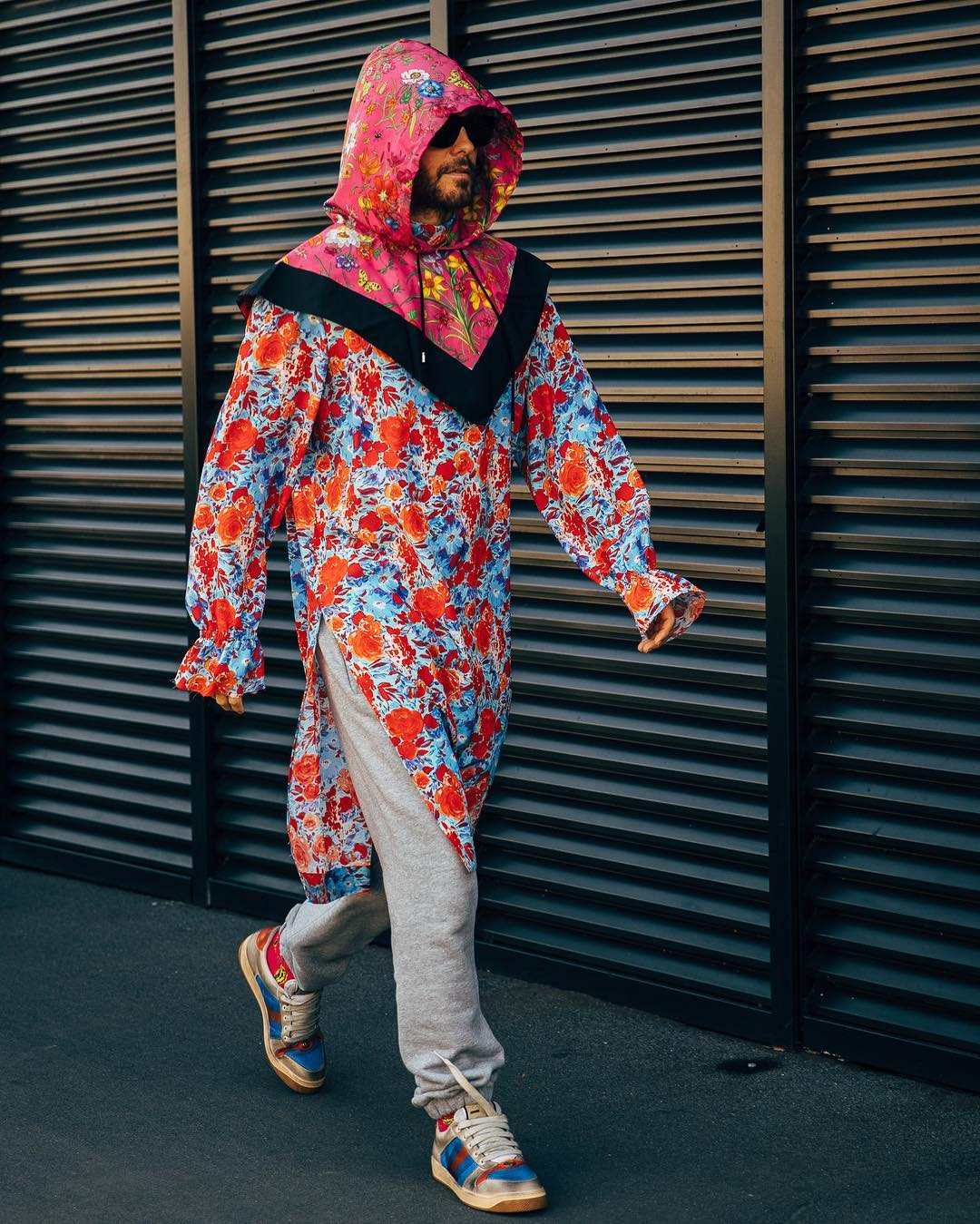 Man walking wearing Gucci