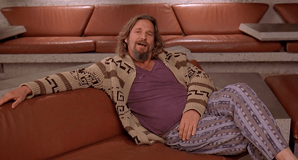 Man in a knitted cardigan sitting on a sofa