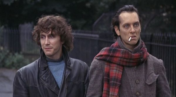 Two men stood outside in coats and scarves