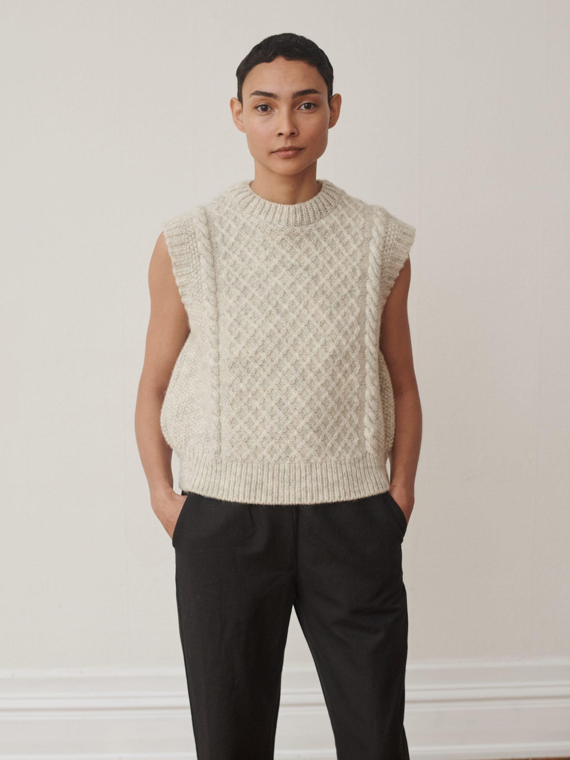 Skall studio model wearing knitted vest