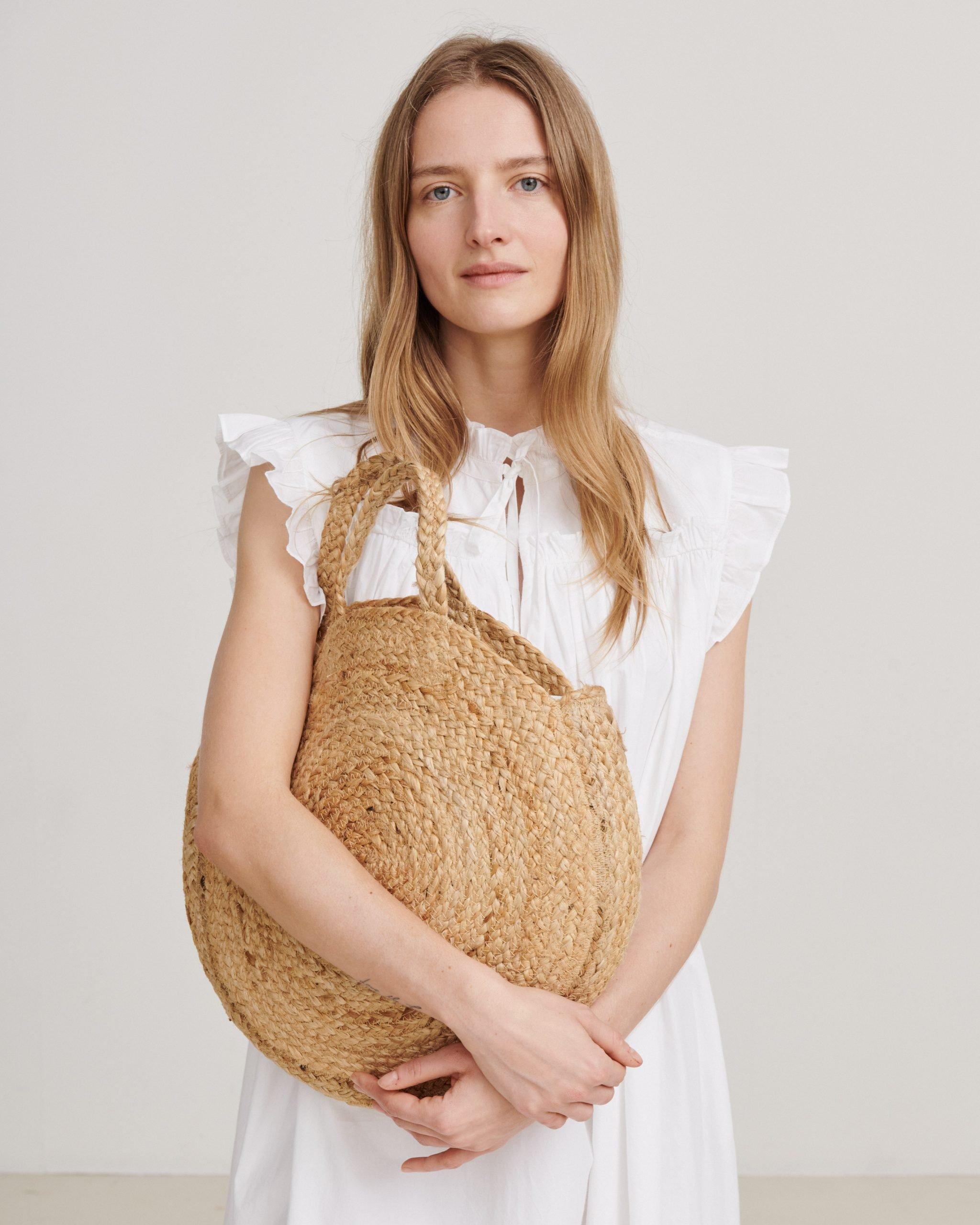 Skall Studio Model holding a bag