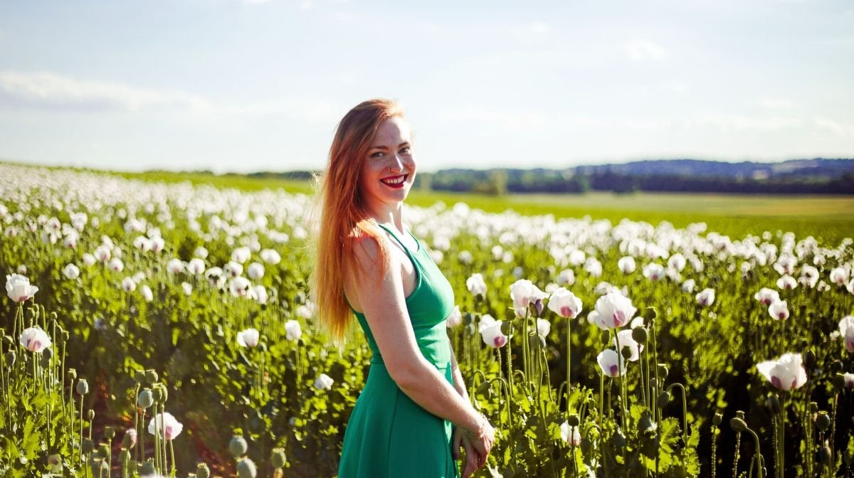 woman with naturally glowing skin enjoying nature