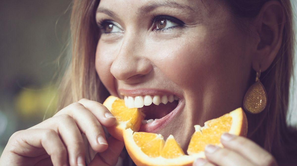 woman eating citrus fruit for vitamin C