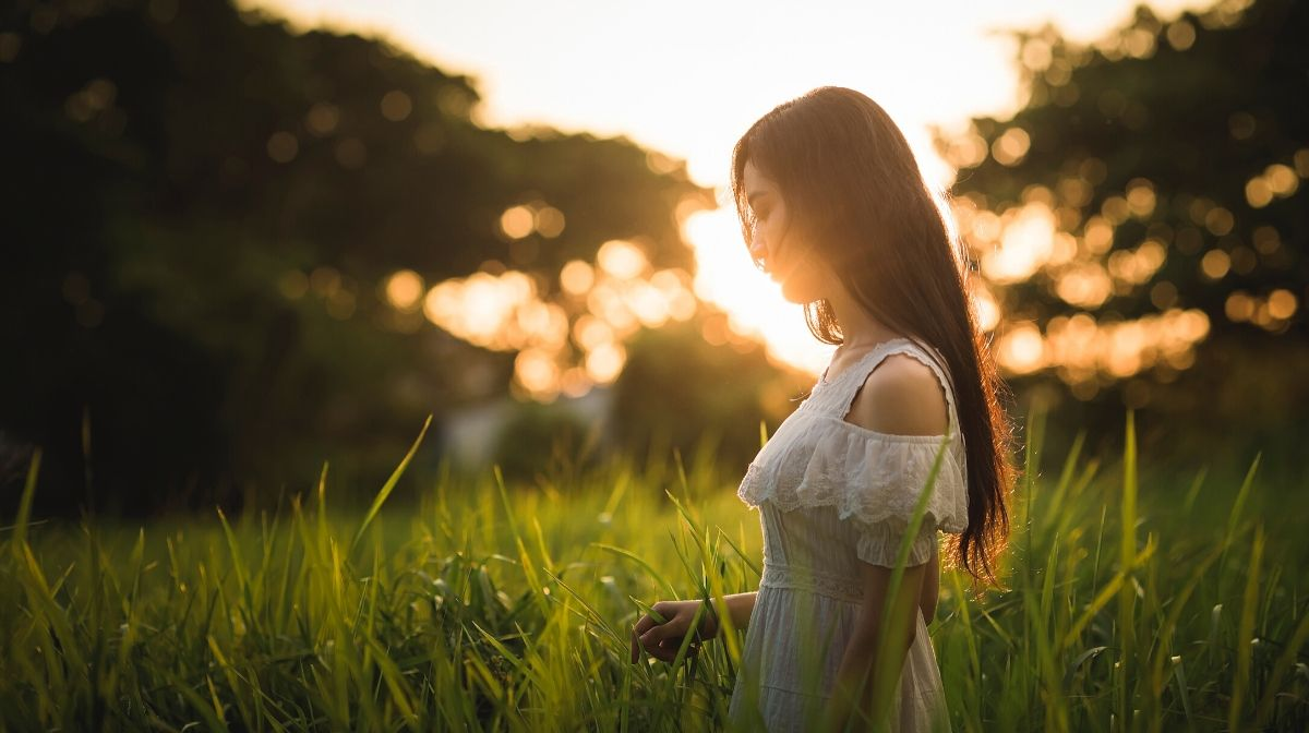 woman with smooth skin in glowing natural sunlight