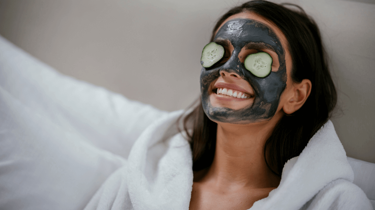 A woman relaxing whilst wearing the Burt's Bees Detoxifying Clay Face Mask