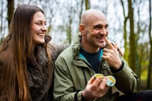 Ed Stafford and Laura Bingham sat outside in the woods using Burt's Bees Res-Q Balm