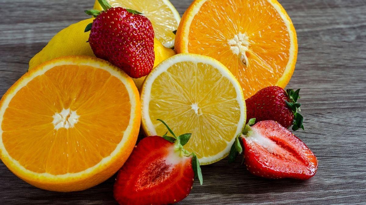 fresh strawberries and oranges