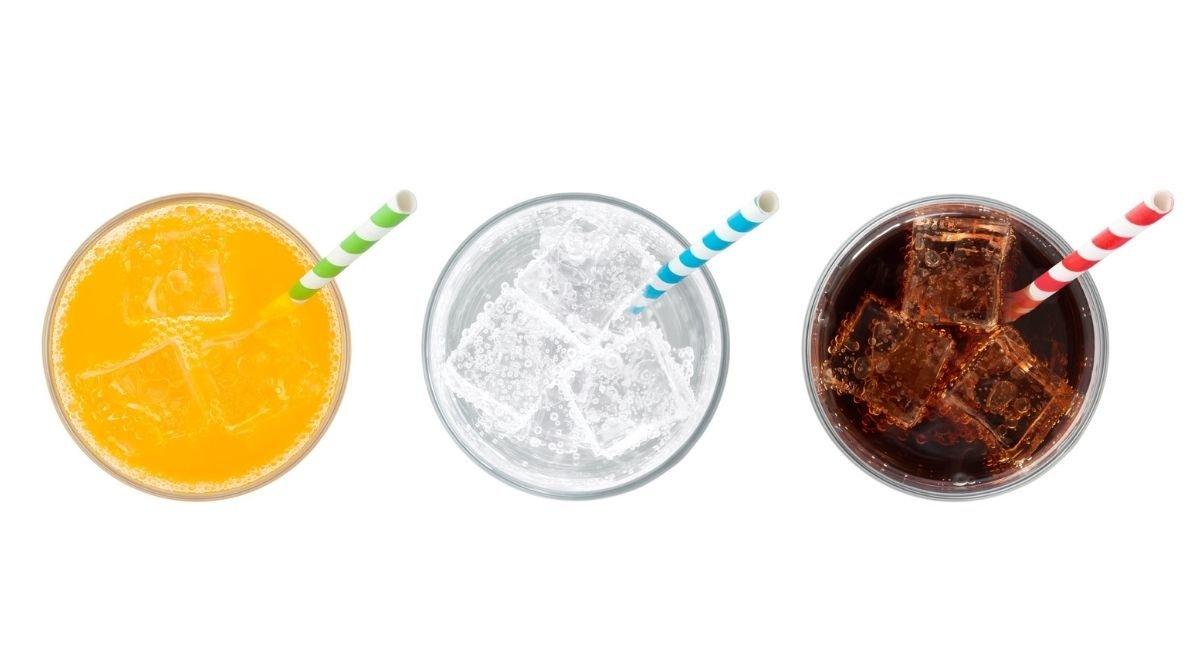 glasses of orange juice, lemonade and coke