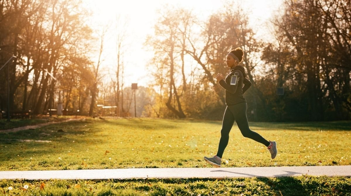 woman running in the park in autumn